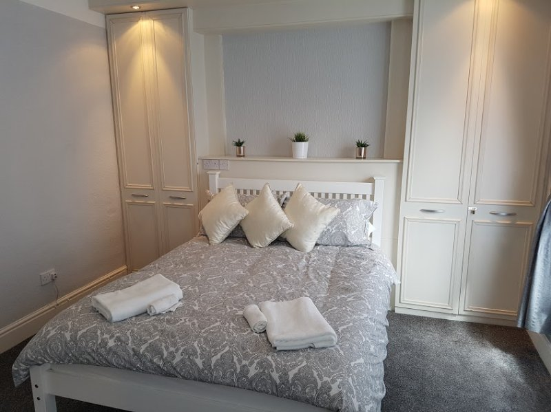 Main bedroom, double bed and wardrobe space.