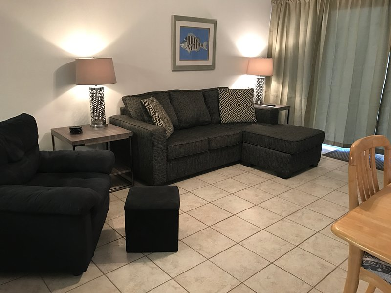 Couch with side chaise; pulls out to a queen size bed.