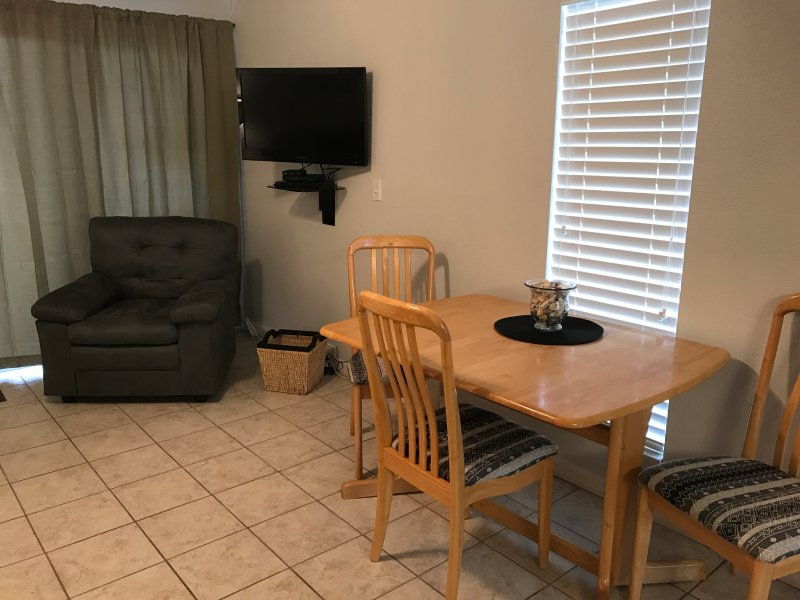 Dining room table and a 32' flat screen TV with a DVD player.
