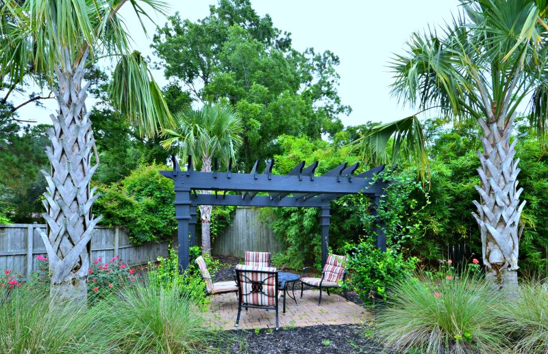 Pergola in backyard with Fire Pit in cool season, or shade in hot summertime.