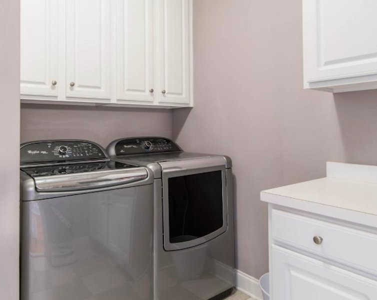 Washer and dryer in utility room.