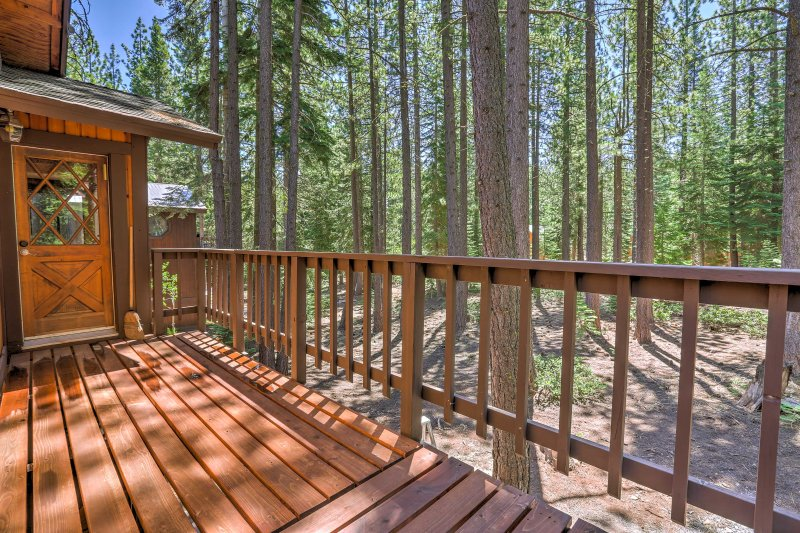 Nestled in the woods, the property enjoys peaceful views and plenty of privacy.