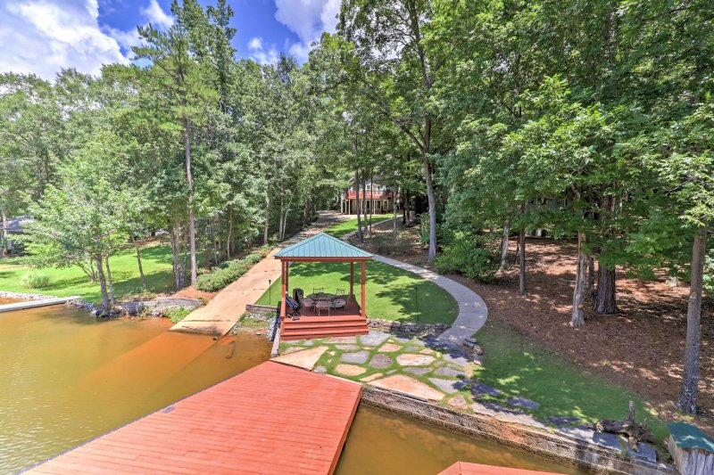 Catch a tan while relaxing on the private dock during your stay at this 5-bedroom, 3-bathroom vacation rental house in Jackson's Gap!