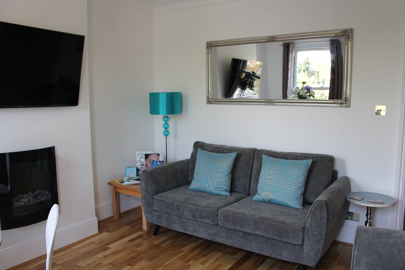 Front room has 3 Seater sofa and 2 x sofa chairs, 1 dinning  table and chairs, Smart TV