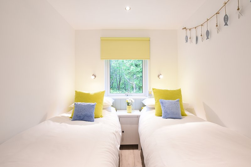 Twin bedroom with direct woodland views. New luxury memory foam mattresses. tV with DVD player.