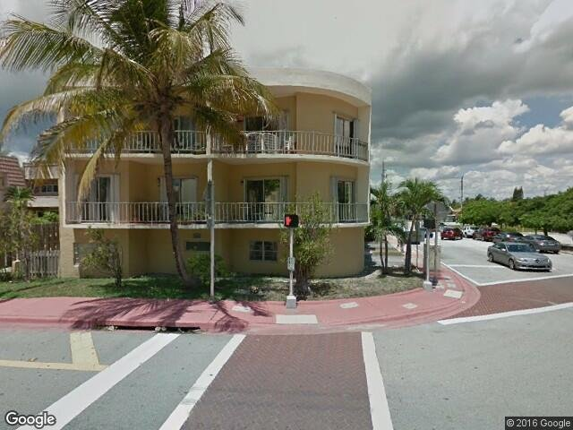 Welcome to Surfside.  Building front, Collins Ave..