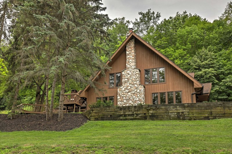 Retreat to this luxurious 4-bed, 2-bath vacation rental chalet in Canandaigua!