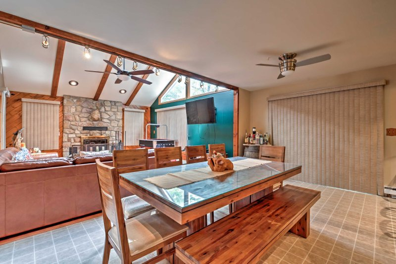 The space flows straight into the dining room featuring a large wood table with seating for 10.
