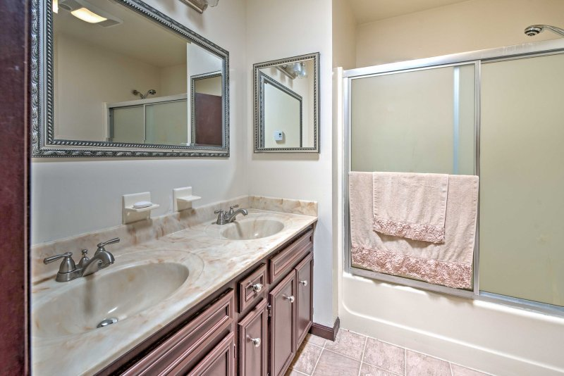 A his and hers sink and shower/tub combo highlight the second bathroom.