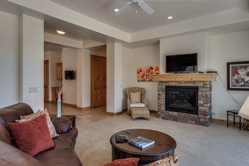 Family room featuring fire place and large flat screen tv