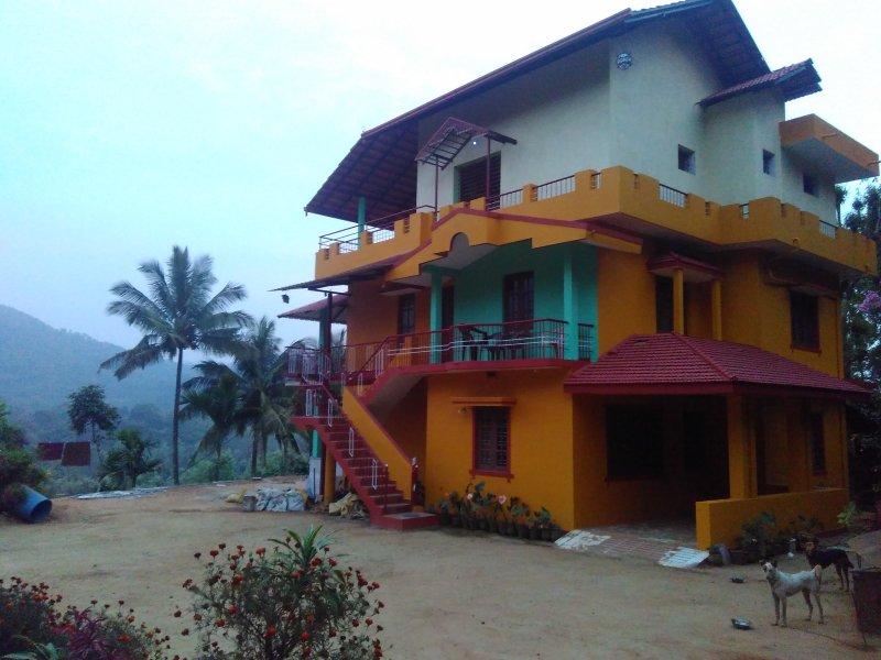 TripThrill Sky Line Estate (5) - 1BHK, vacation rental in Virajpet