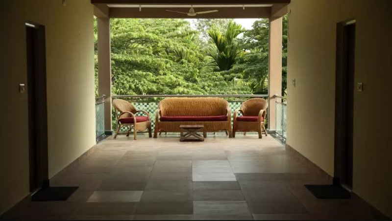 TripThrill Palm Era Deluxe Room 3, holiday rental in Kushalnagar