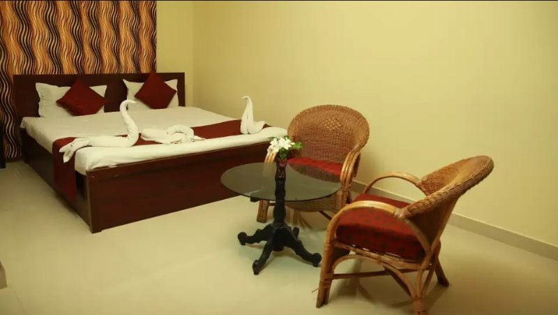 TripThrill Palm Era Deluxe Room 12, holiday rental in Kushalnagar