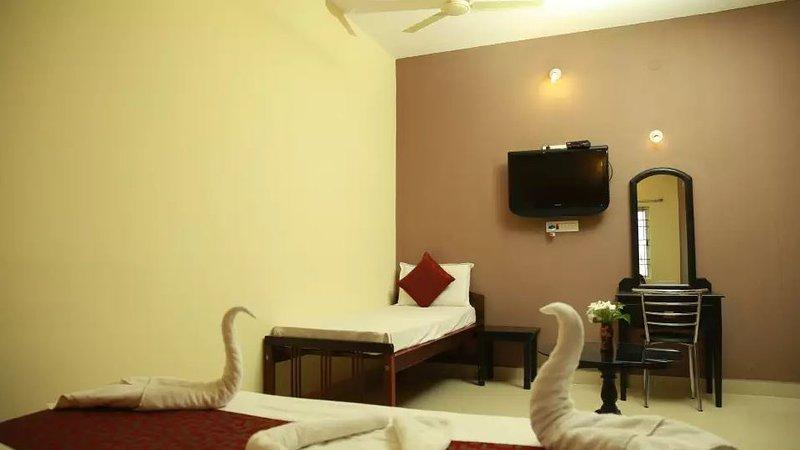 TripThrill Palm Era Deluxe Room 9, holiday rental in Kushalnagar