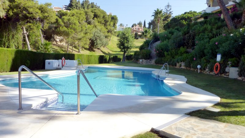 Our pool with golf club in background