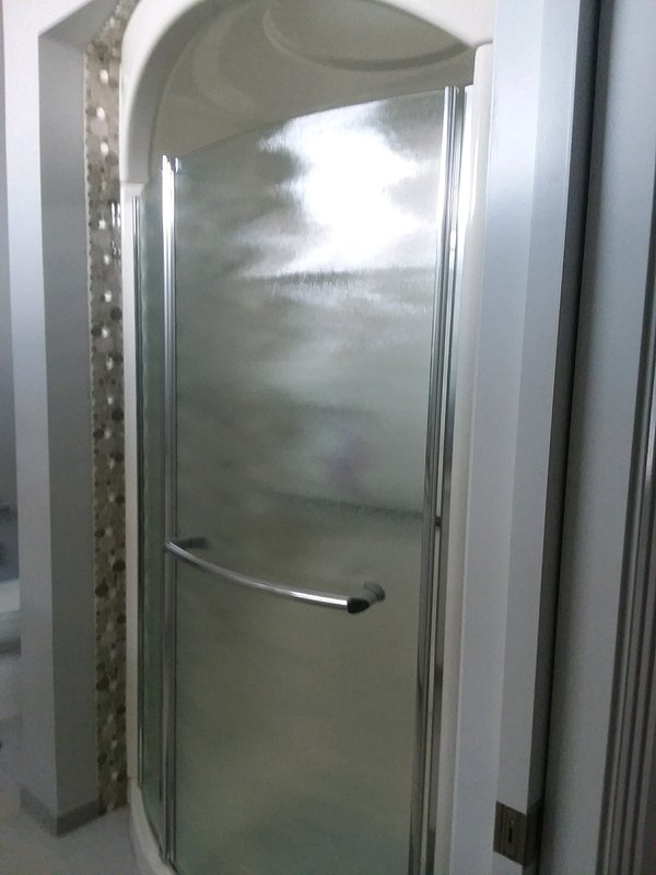 Walk in shower with a bench