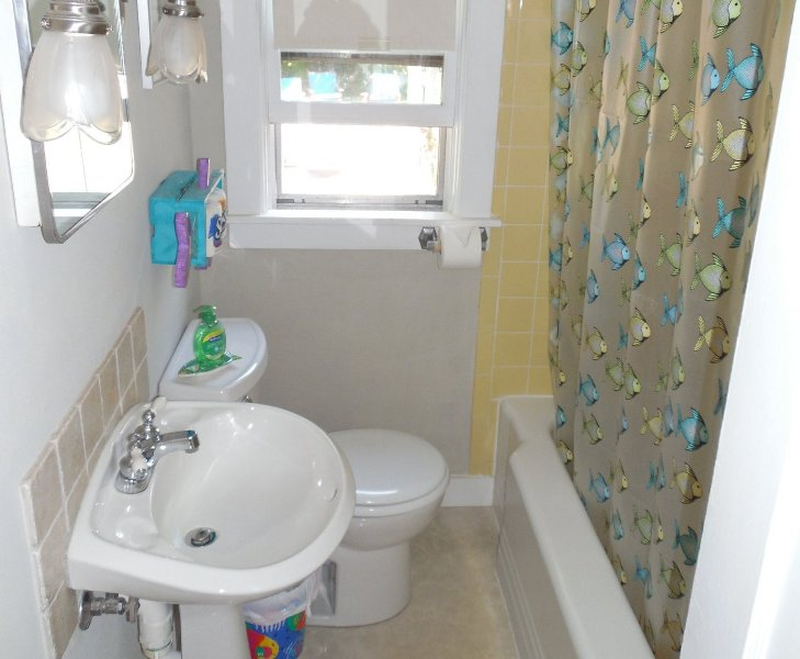 The bathroom. Small, clean and whimsical. We also have an outdoor shower.