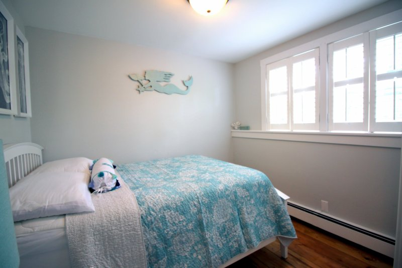 The Mermaid Room with queen bed overlooking a private yard