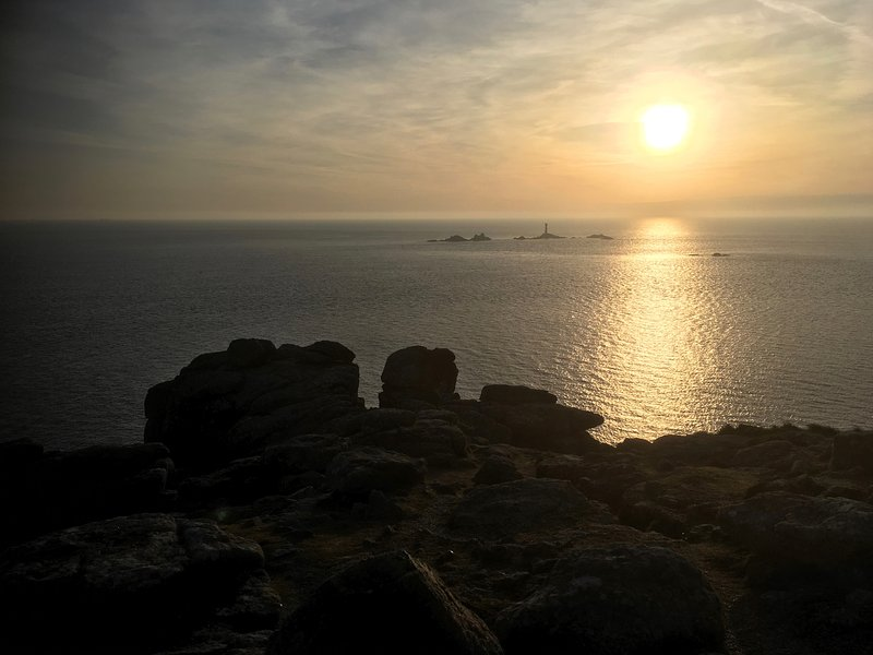 Sunset over the Longships Lighthouse from Land's End