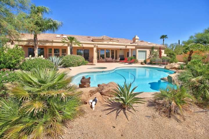 Stunning backyard with large heated pool, hot tub, outdoor fireplace and lots of outdoor seating