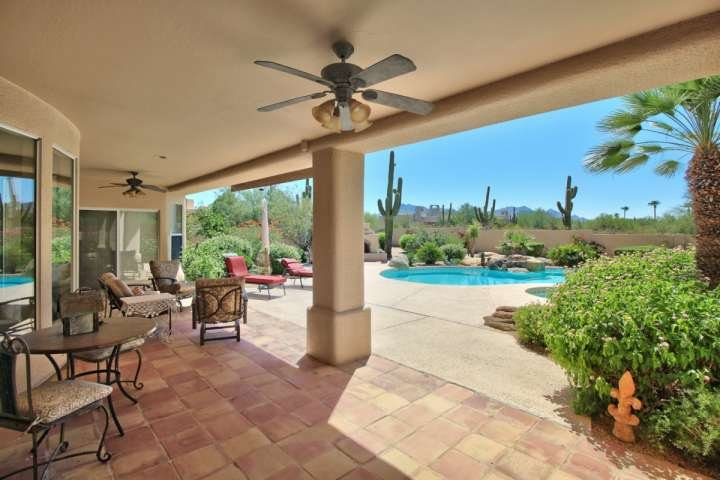 Backyard patio with stunning yard