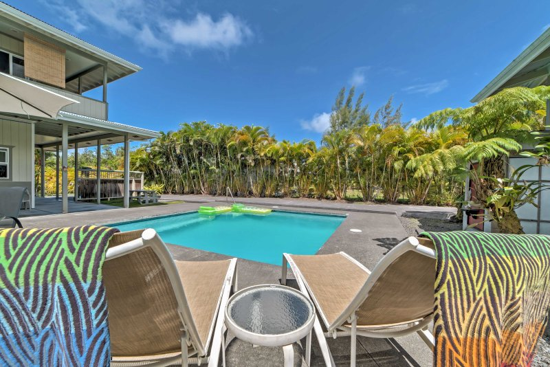 Get a tan by the pool during your stay at this studio apartment in Keaau!