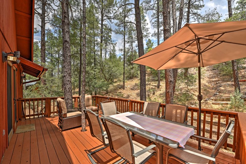 Enjoy beautiful views of tall pines and small oaks when you stay at this private 2-bedroom, 2-bathroom vacation rental cabin that lies adjacent to Prescott National Forest!