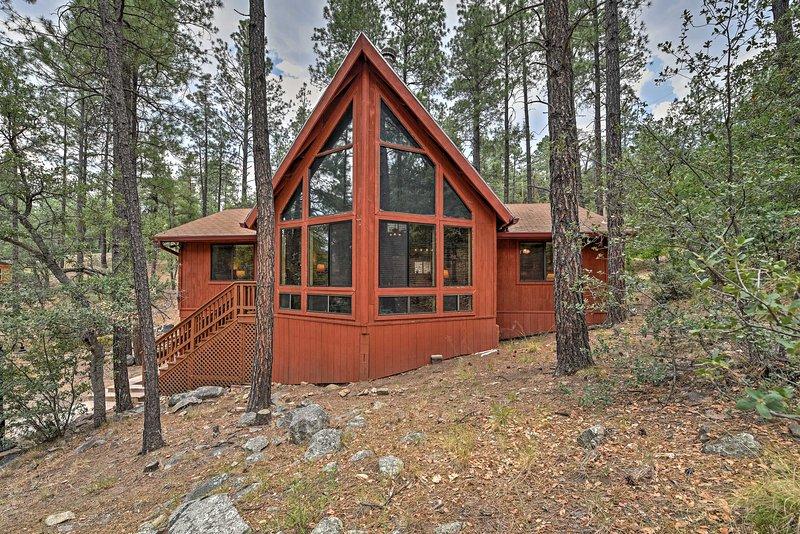 This Prescott A-frame home boasts over 1,000 square feet of cozy living space.