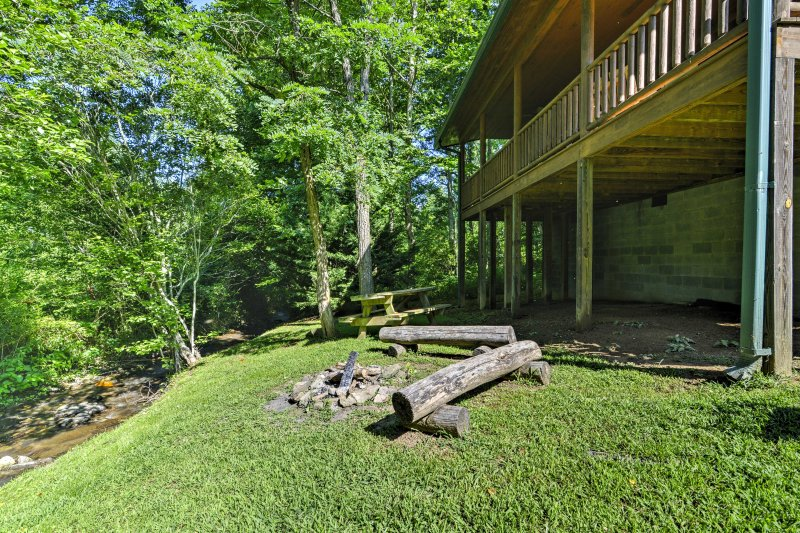 Look forward to a memorable getaway at 'Fox Creek Waterside Cabin,' a charming 2-bedroom, 1-bath vacation rental cabin in Bryson City.
