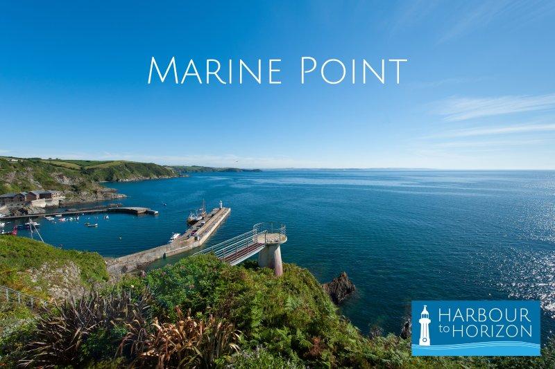 """Ponto Marinho se senta na borda do penhasco com vistas deslumbrantes a partir da varanda de """"porto para horizon"""""""