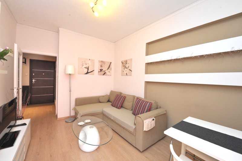Cosy living room with comfortable corner sofa and flat screen TV!