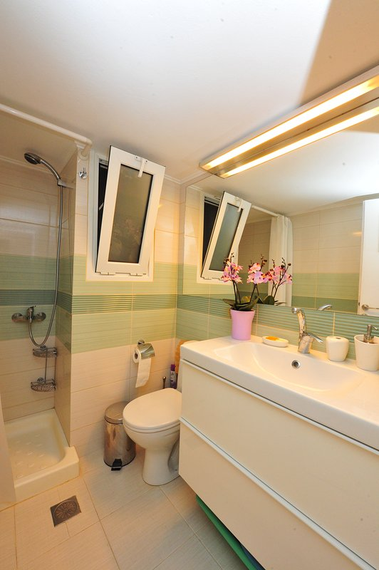 The bathroom. Enjoy a hot shower after a day of exploring the city!
