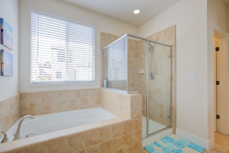 Full bathroom with shower and toilet. Essentials like shampoo, conditioner, soap are provided