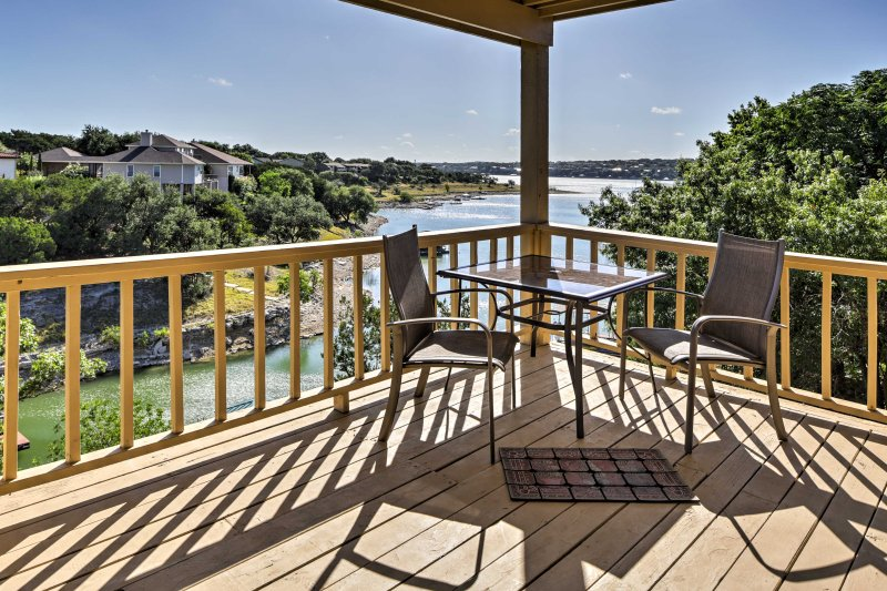 Take in the lake views from one of the private decks of this charming 2-bedroom, 2-bath vacation rental townhome in the Point Venture retreat community!