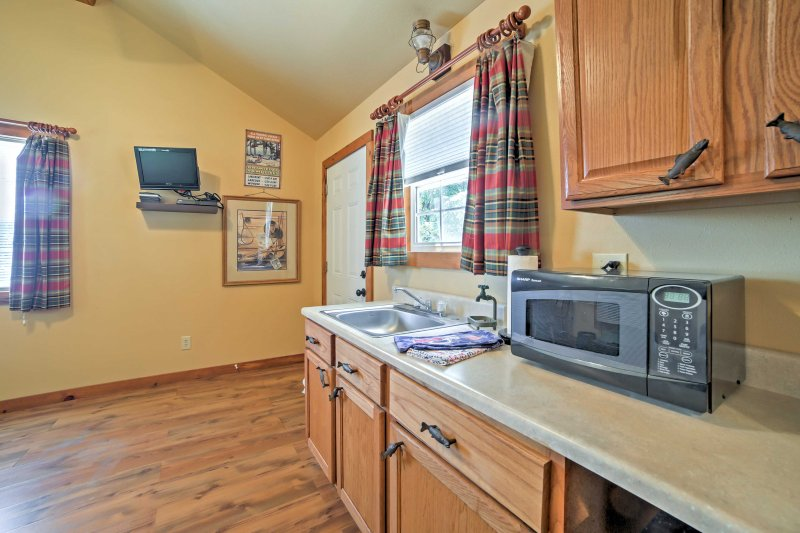 The well-equipped kitchenette features a mini-fridge and microwave.