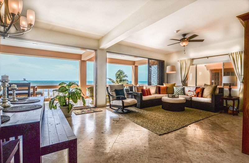Gorgeous open-concept living/dining with accordion doors that open completely to oceanfront balcony!