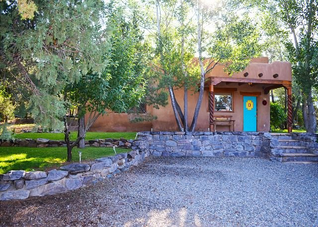 A paradise private setting half way betweein Town of Taos and Taos Ski Valley with panoramic mountain views, hot tub, tastefully furnished charming beyond description