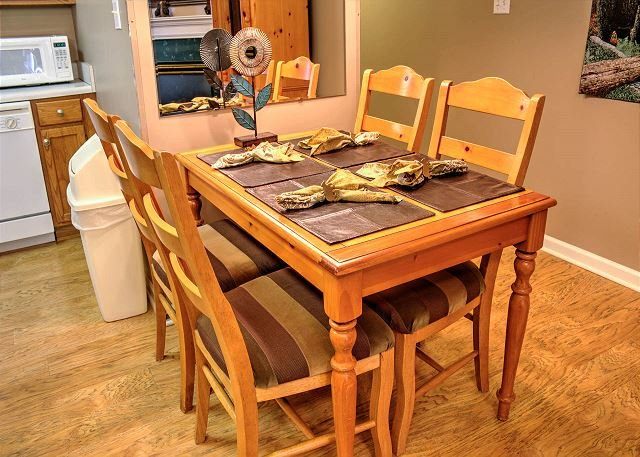 Dining for 4 with hardwood floor