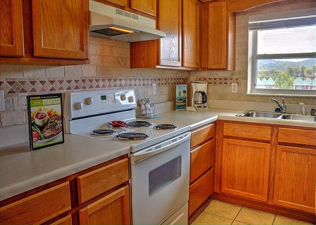 Full Kitchen with a Tiled Backsplash