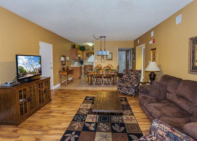 Living Room w/Hardwood Flooring - Hardwood floors with flat scre