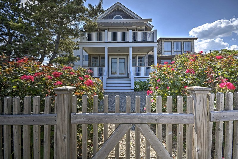 Gather your loved ones for an unforgettable getaway at this 5-bedroom, 3-bath Sea Bright vacation rental home, right across the street from the beach.