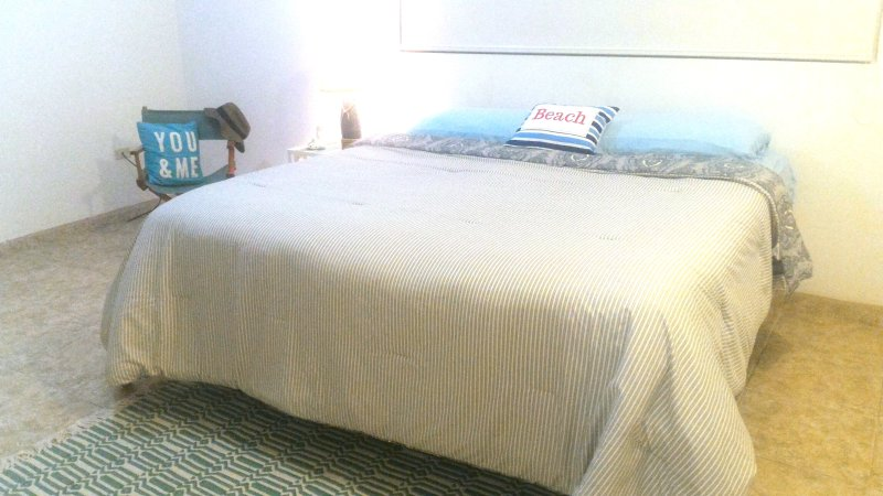 Master bedroom with sofa bed and A/C