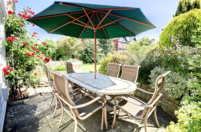Space for outdoor dining & a BBQ is provided
