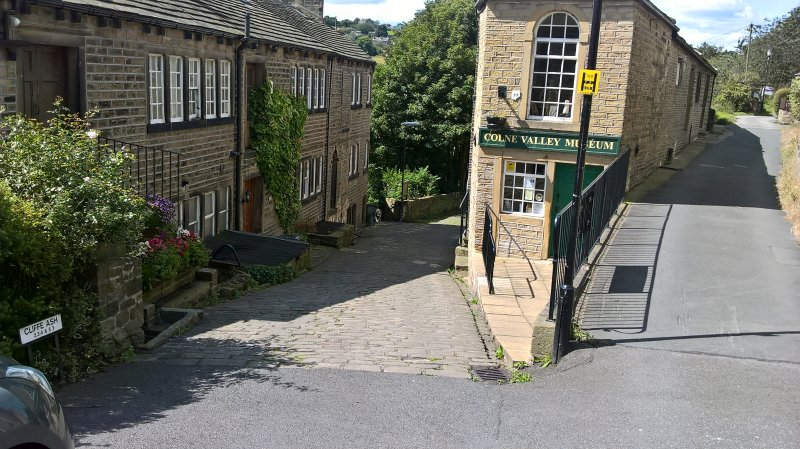 A cobbled street near the cottage with the Colne Valley Museum