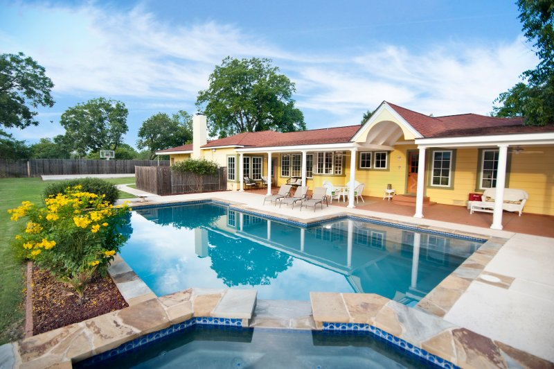 Sunshine Haus has a 40,000 gallon gray bottom pool and hot tub.