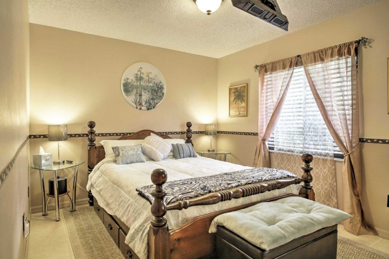 A restful night of sleep can be found on this queen-sized bed.
