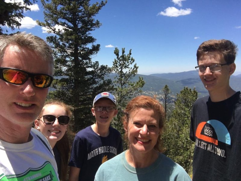 Our family enjoying the views and weather in Angel Fire.
