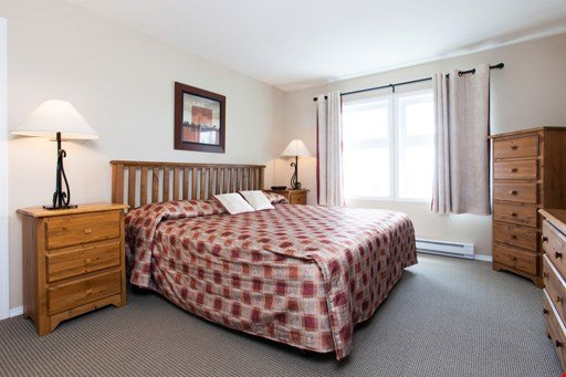 The second bedroom features a comfortable queen bed and ample cupboard space to store your belongings.