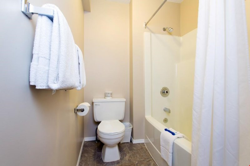 Get ready for the day in the full modern bathroom, complete with shower-tub combination and vanity.