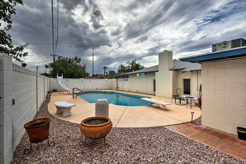 Splash around in the private pool, complete with a water slide and diving board!